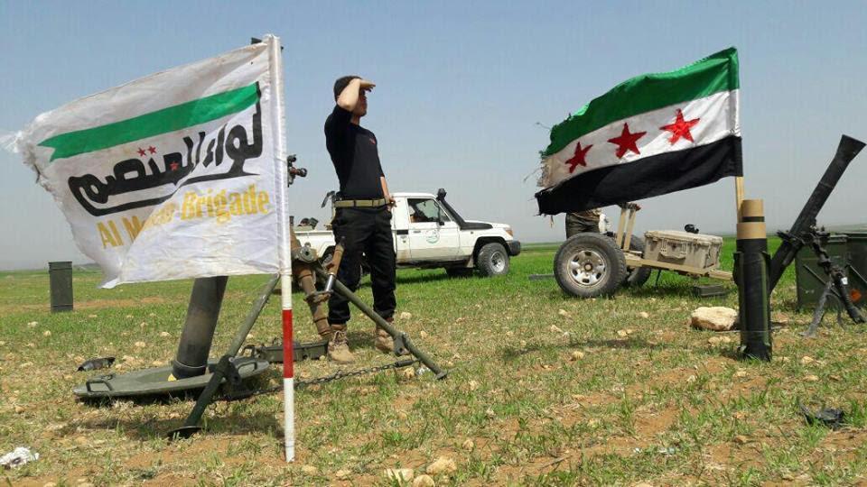 عناصر من لواء المعتصم على إحدى جبهات ريف حلب